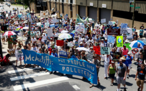 Protesters march to Executive Mansion to protest pipelines, energy policy
